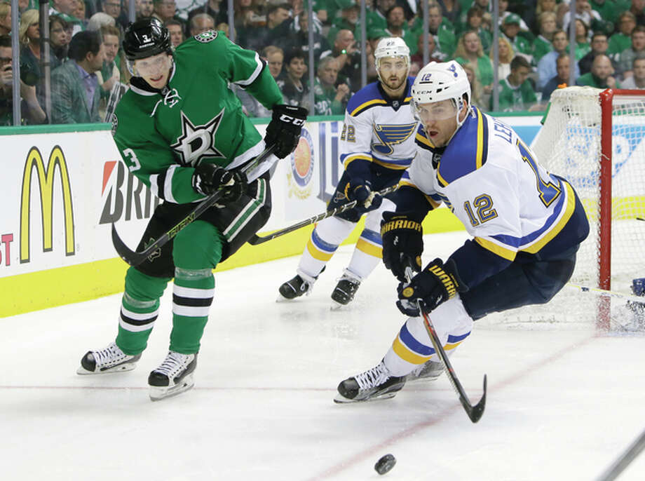 The Blues' Jori Lehtera (right) and the Stars' John Klingberg chase the puck during the first period in Game 1 in the second round of the NHL Stanley Cup playoffs Friday in Dallas. Photo: Associated Press