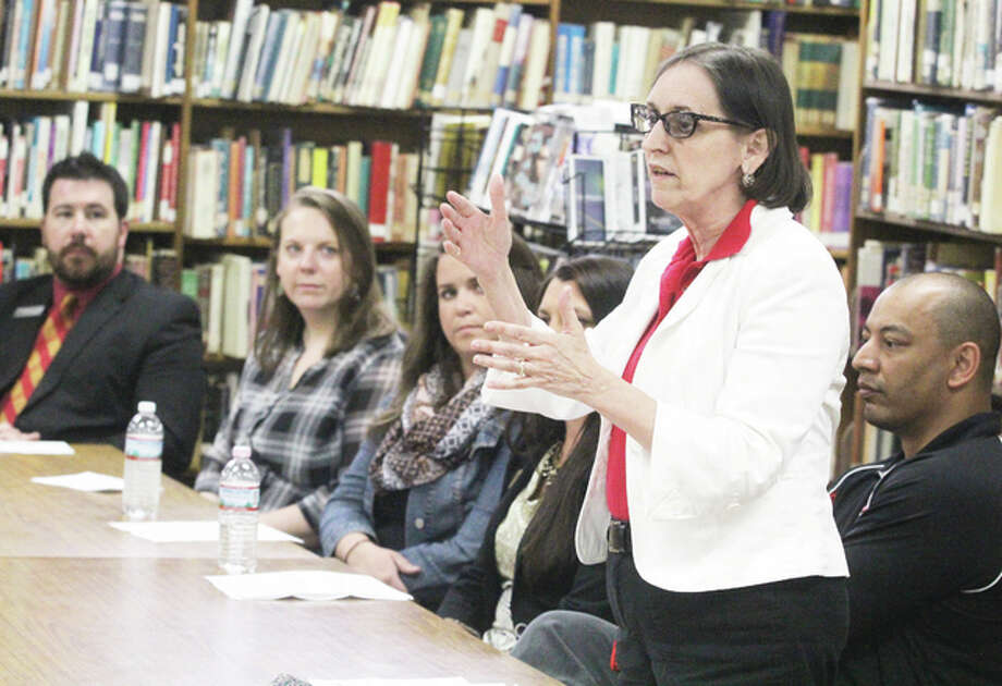 Scott Cousins/The Telegraph Jane Kelsey, director of admissions at Blackburn Collge in Carlinville, talks to East Alton Wood River High School students and parents about changes in the FAFSA application during a college night for juniors, held Tuesday at EAWR.