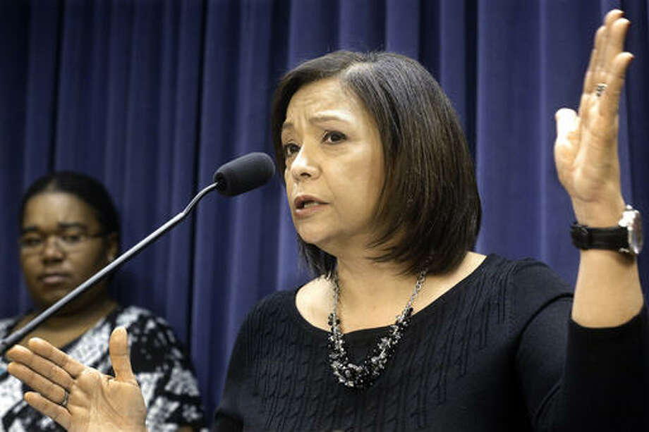 In this Jan. 13, 2016 photo, Illinois Sen. Iris Martinez, D-Chicago, speaks to reporters during a news conference at the Illinois State Capitol in Springfield, Ill. Martinez is sponsoring legislation that would make Illinois among the few states in the country letting immigrant students get financial aid regardless of their legal status.