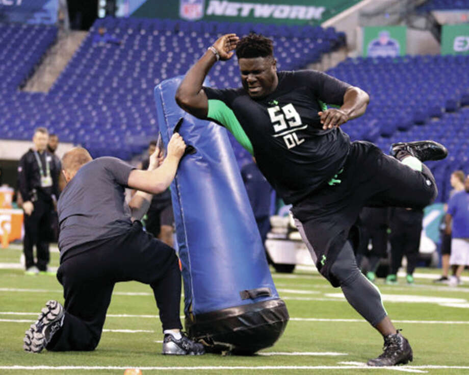 Nebraska junior Vincent Valentine (right), a defensive tackle from Edwardsville, works through a drill and the NFL Combine in Indianapolis. Valentine was selected in the third round of the NFL Draft on Friday by the New England Patriots. Photo: Associated Press