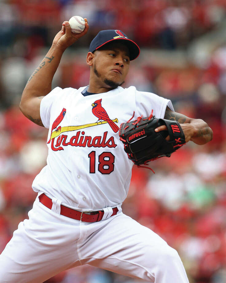 Cardinals starting pitcher Carlos Martinez throws during the first inning of Sunday's game against the Washington Nationals at Busch Stadium. The Nationals handed Martinez his first loss and swept the three-game series in St. Louis Photo: Billy Hurst / For The Telegraph