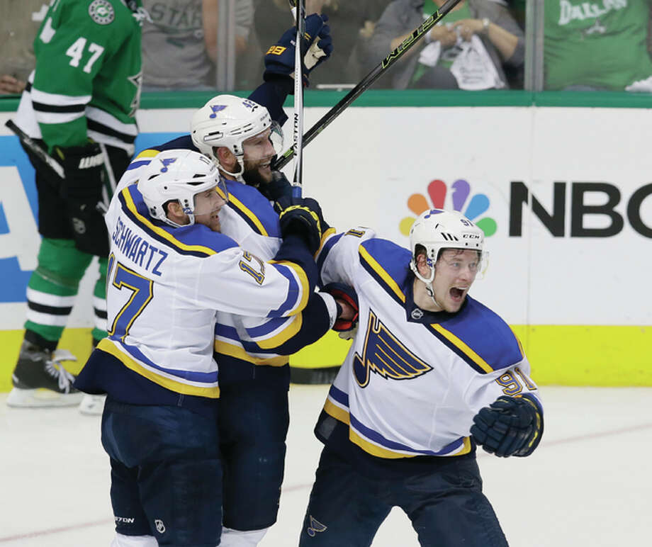 Blues captain David Backes (middle) celebrates his goal with teammates Jaden Schwartz (left) and Vladimir Tarasenko (right) to give the Blues a 4-3 overtime victory over the Stars on Sunday in Game 2 of the Stanley Cup Western Conference semifinals in Dallas. Photo: Associated Press