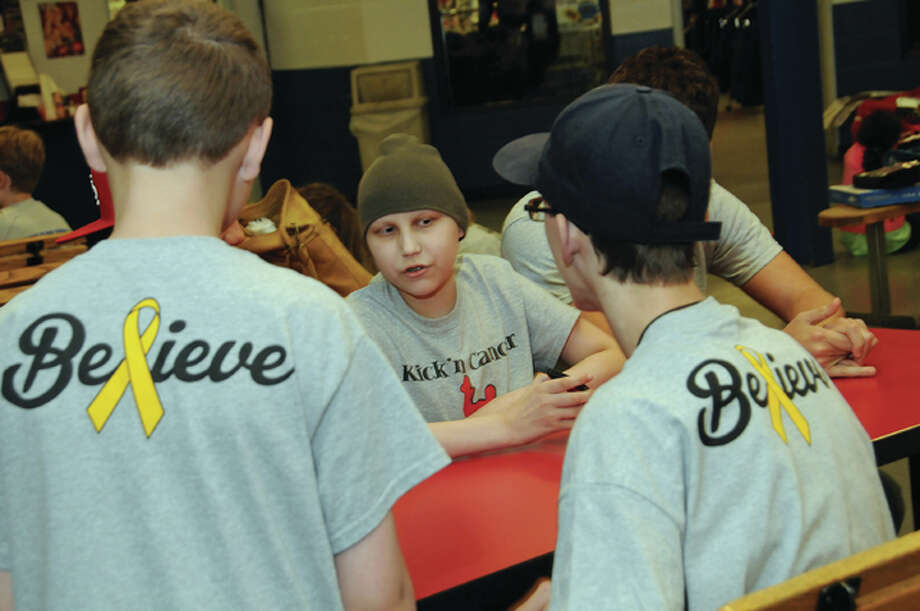 Collin Rives, 13, of Edwardsville, center, with friends at Saturday's Kick'n Cancer for Collin event held Saturday at the East Alton Ice Arena. The event raised funds in support of Rives and his family, as he battles bone cancer.