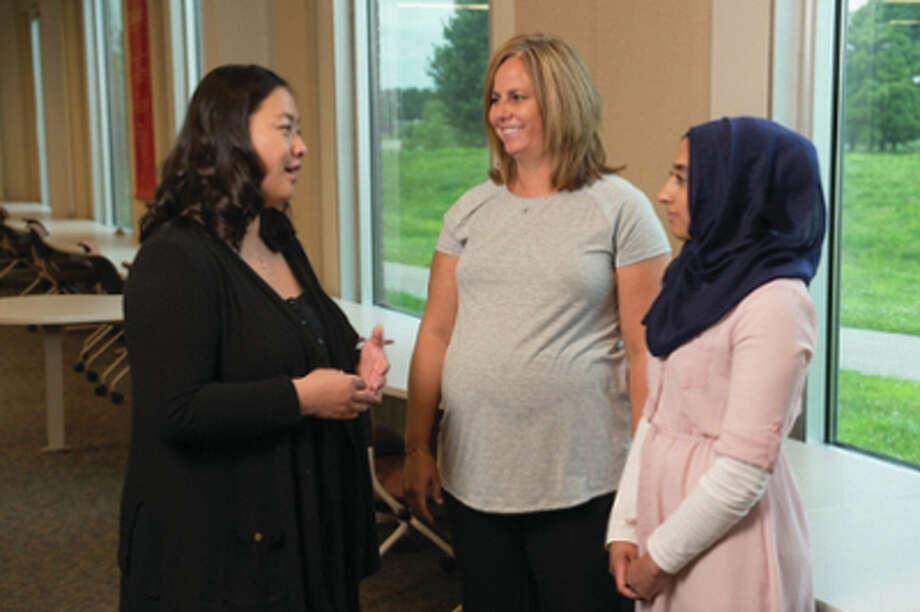 Pictured from left to right, SIUE School of Pharmacy's Jingyang Fan, PharmD program, a clinical associate professor of pharmacy practice, Lisa Lubsch, PharmD program, also a clinical associate professor of pharmacy practice and student Sara Mohiuddin.