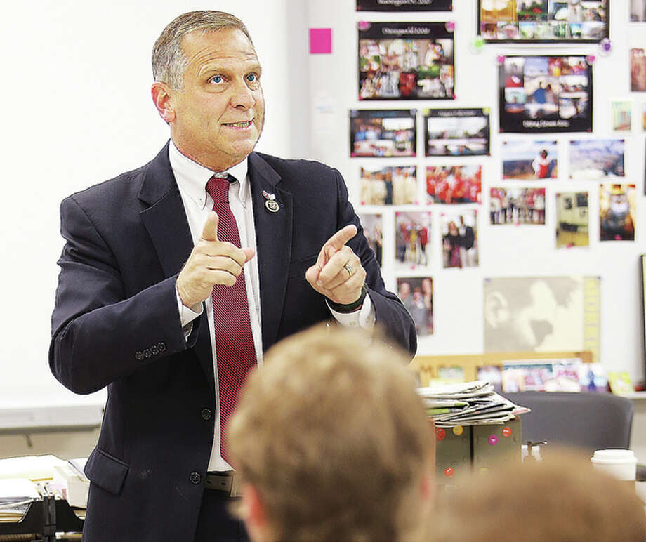 U.S. Rep. Mike Bost, R-Murphysboro, talks to Alton High School social studies students Monday during a visit to the school for Teacher and Staff Appreciation Week.