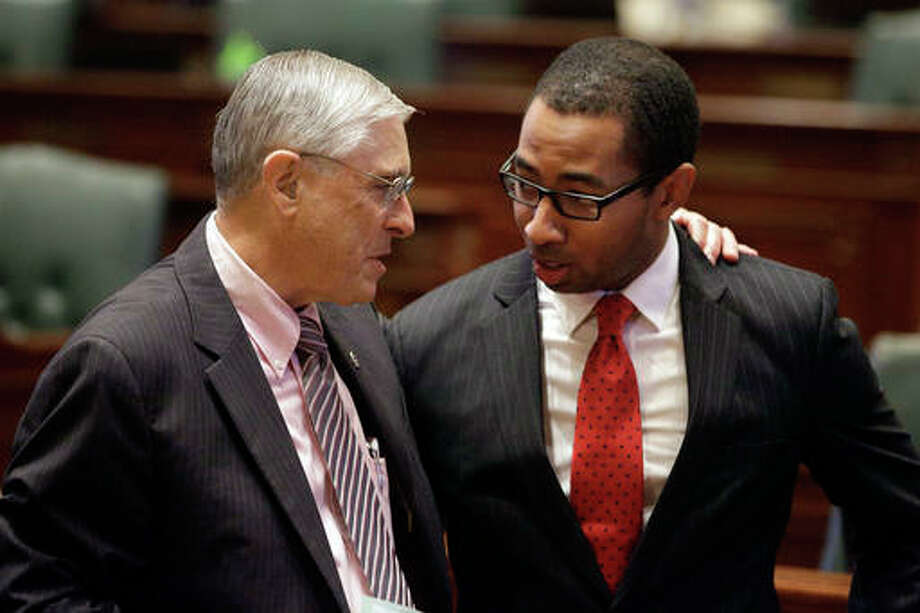 Illinois Rep. Christian Mitchell, D-Chicago, right, and Illinois Rep. Robert Pritchard, R-Sycamore, left, talk while on the House floor during session at the Illinois State Capitol Tuesday, May 3, in Springfield, Ill. Illinois House Democrats who want the state to tax millionaires at higher rates plan to take up a measure that would ultimately let voters decide in November. AP Photo/Seth Perlman