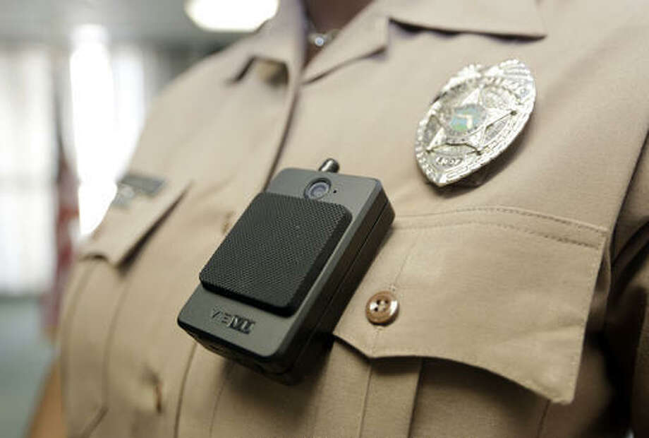 A body camera is worn by Miami-Dade Police Department PIO Marjorie Eloi, which 1,000 officers will begin using over the next few months, during a news conference, Thursday, April 28, 2016, in Doral, Fla. Police body cameras have become more popular following a number of controversial officer shootings around the country. (AP Photo/Lynne Sladky)