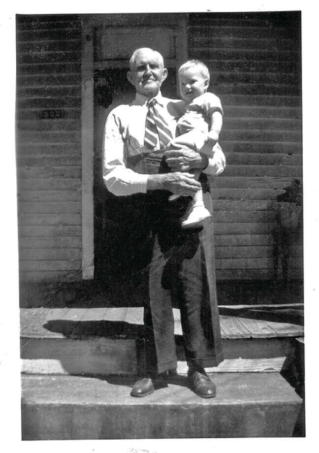 Eugene Jones Baldwin held by his great grandpa Homer Miller in 1949. Photo: For The Telegraph