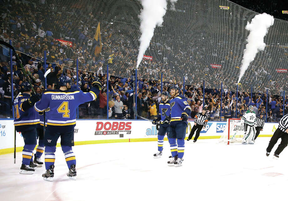 St. Louis Blues' Vladimir Tarasenko, far left, of Russia, is congratulated by teammates after scoring during the second period of Game 3 of the NHL hockey Stanley Cup Western Conference semifinals against the Dallas Stars, Tuesday, May 3, 2016, in St. Louis. (AP Photo/Jeff Roberson)