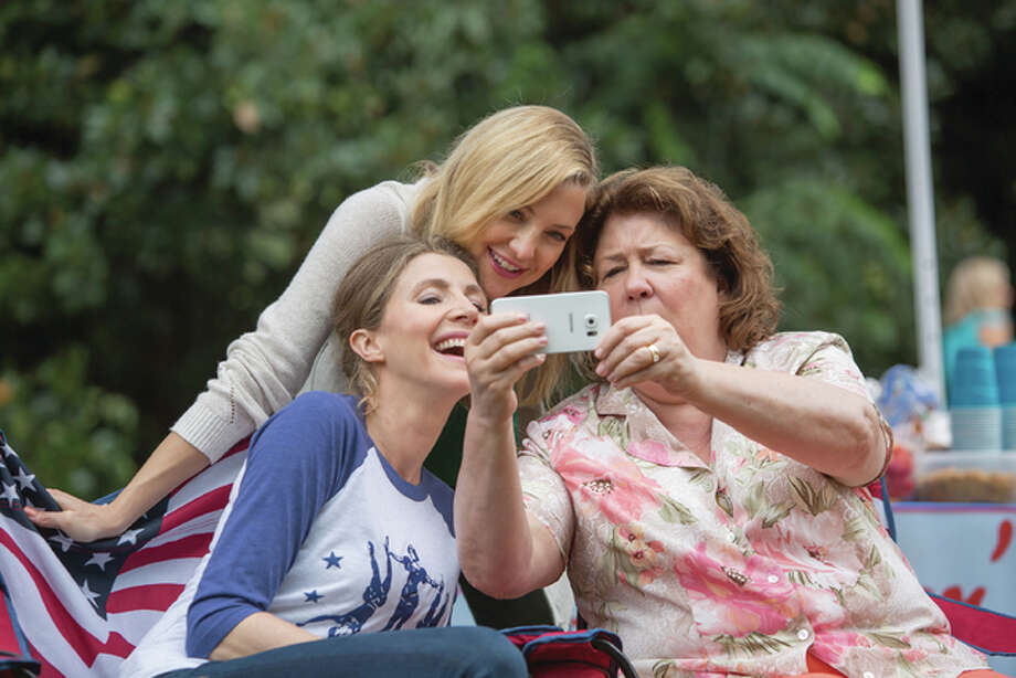 "Left to right, Sarah Chalke, Kate Hudson and Margo Martindale in ""Mother's Day,"" directed by Garry Marshall and also starring Jennifer Aniston, Julia Roberts, Jason Sudeikis, Britt Robertson, Timothy Olyphant and Hector Elizondo. Photo: Ron Batzdorff / Open Road Films 