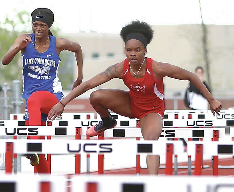 Alton senior LaJarvia Brown, shown on her way to a hurdles victory in the Alton Invite on April 21 at Alton High, won three events and was second in another Wednesday at the Southwestern Conference girls track meet in Edwardsville. Photo: Scott Kane / For The Telegraph