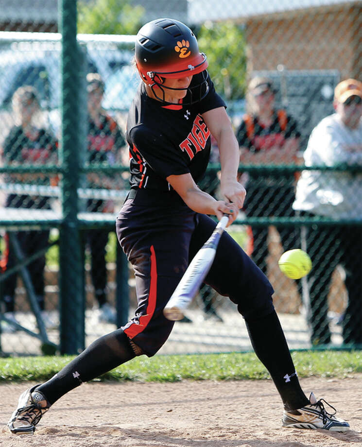 Edwardsville's Sarah Hangsleben connects for a walk-off three-run homer to beat the Alton Redbirds on Thursday at the District 7 Sports Complex in Edwardsville. The home run was Hangsleben's 10th of the season. Photo: Scott Kane / For The Telegraph
