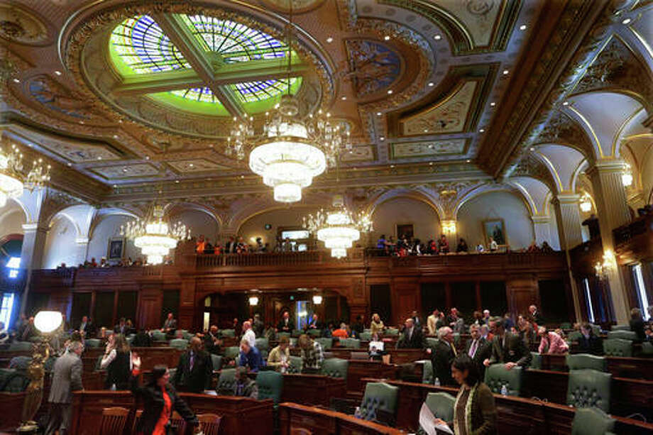 In this Feb. 16, 2016 file photo, Illinois House of Representative lawmakers meet on the House floor during session at the state Capitol in Springfield, Ill. Illinois State University has fared better than most others across the state amid the ongoing budget crisis, according to school officials. Illinois State has been spending below the level authorized by its board of trustees as it waits to see how much money it will receive from the state. The board in October approved a $422 million operations budget under the assumption that there would be a 10 percent cut in state appropriations compared with the previous fiscal year.