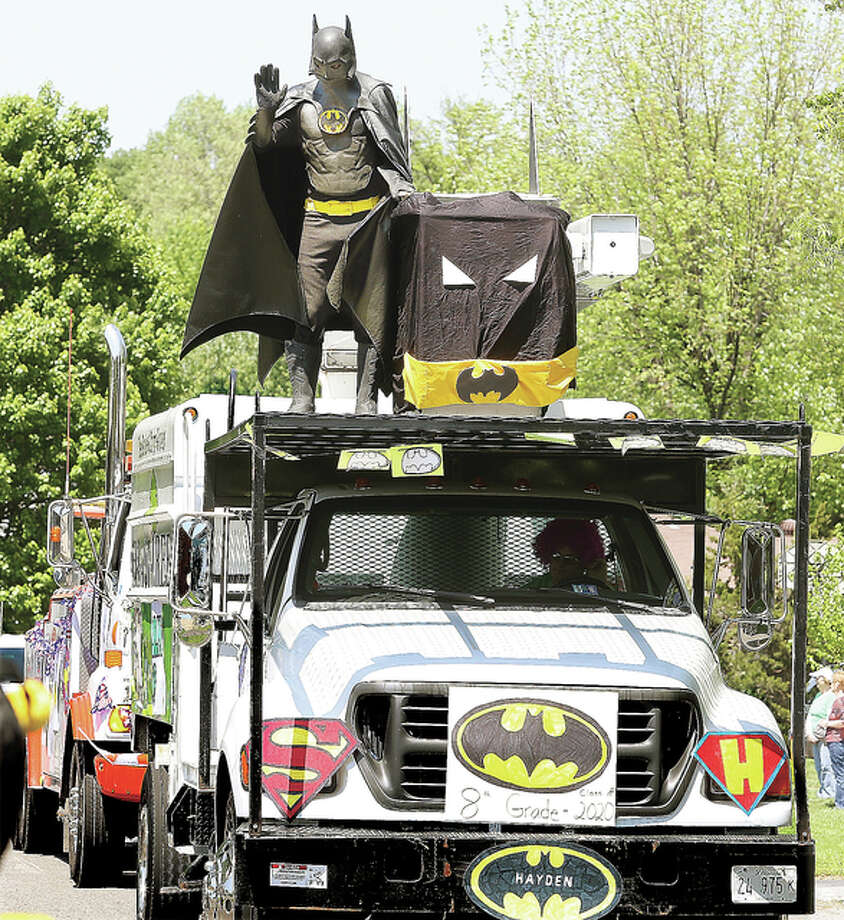 One of Hayden Eberlin-Brown's loves are superheroes, and there were several in his parade Friday, including a Batman atop a tree service truck.