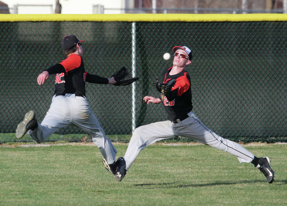 Gillespie left fielder Nick Jarman (left) and center fielder Nick Wyatt converge on the baseball during the Miners' season-opening win March 16 at Ken Schell Field in Jerseyville. Gillespie dropped to 12-13 Friday with a SCC loss at Southwestern. Photo: James B. Ritter / For The Telegraph