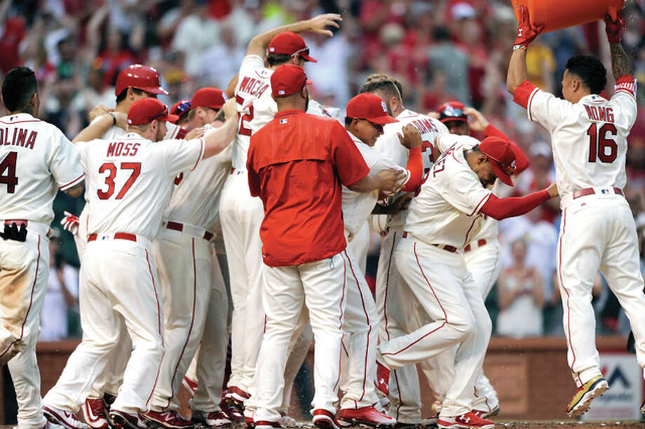 The Cardinals celebrate a two-run walkoff home run by Matt Carpenter in the ninth inning Saturday at Busch Stadium. The Cardinals won 6-4. Photo: Bill Boyce | AP Photo