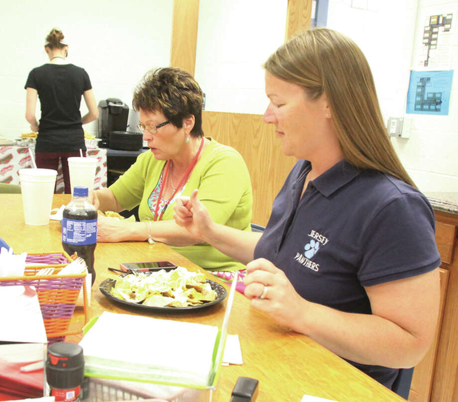 Barbara Smith, right, and Dorothy Wuellner, both second-grade teachers at Jerseyville East Elementary School, eat a taco bar lunch Friday as part of Teacher Appreciation Week. Schools throughout the area have been honoring and celebrating teacher, with breakfast, lunch and treats a common theme.