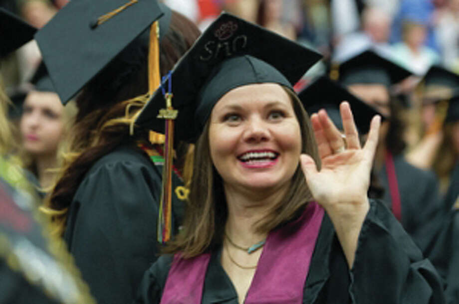 SIUE School of Nursing graduate Lauren Castro waves to her family during spring 2016 commencement exercises at the Vadalabene Center.