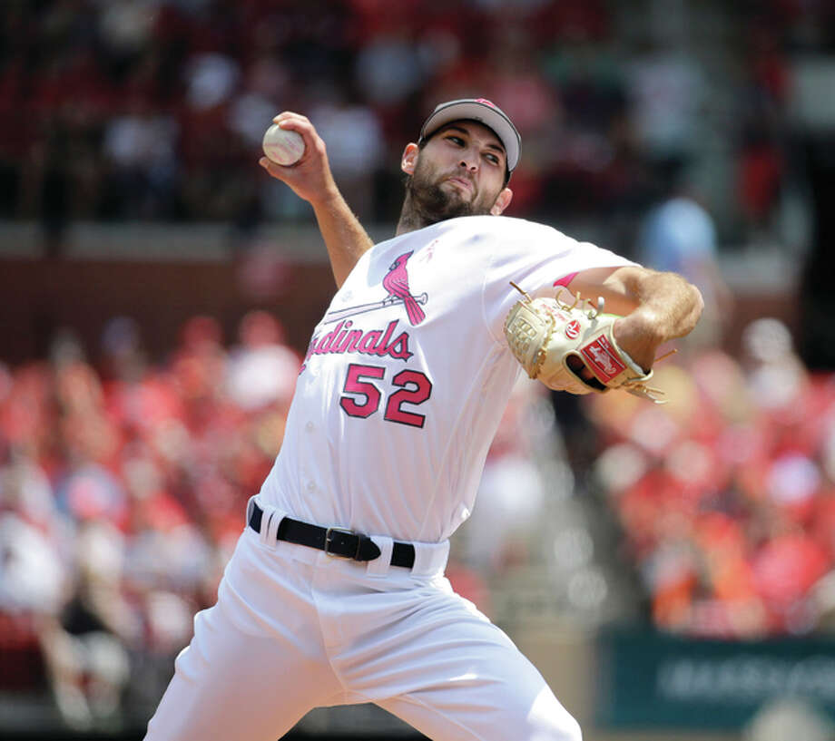 Cardinals pitcher Michael Wacha throws during the first inning against the Pittsburgh Pirates on Sunday at Busch Stadium in St. Louis. Photo: Associated Press