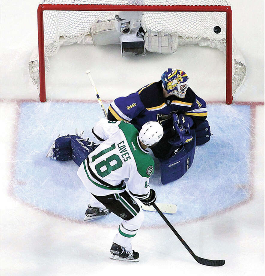 The Dallas Stars' Patrick Eaves (18) watches as a shot by teammate Jason Spezza slips past Blues goalie Brian Elliott for a first-period goal in Game 6 of their Stanley Cup Western Conference semifinals Monday in St. Louis. Photo: Jeff Roberson | AP Photo