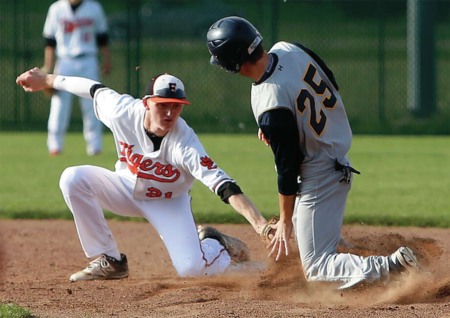 Edwardsville shortstop Andrew Yancik (left) tags out O'Fallon courtesy runner Hayden Schaefer as he attempts to steal second base during the fourth inning Tuesday at Tom Pile Field in Edwardsville. Photo: Scott Kane / For The Telegraph