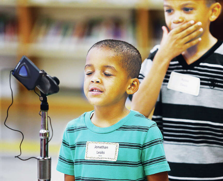 North Elementary School kindergarten student Jonathan Leaks gives his word a little thought Tuesday at a spelling bee for kindergarten students at the Godfrey school. Leaks didn't win the competition, but like many of the students he held on through several rounds. Lennon Otero-DeVors won the contest.