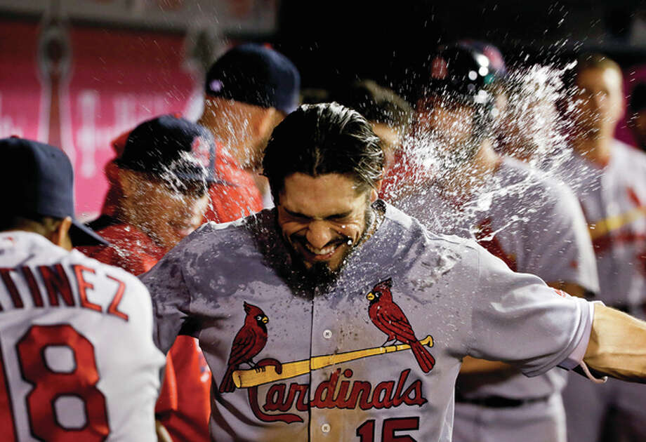 The Cardinals' Carlos Martinez (left) empties a cup of water at Randal Grichuk after Grichuk's two-run home run against the Los Angeles Angels during the fifth inning of a baseball game in Anaheim, Calif., on Tuesday night. Photo: Associated Press
