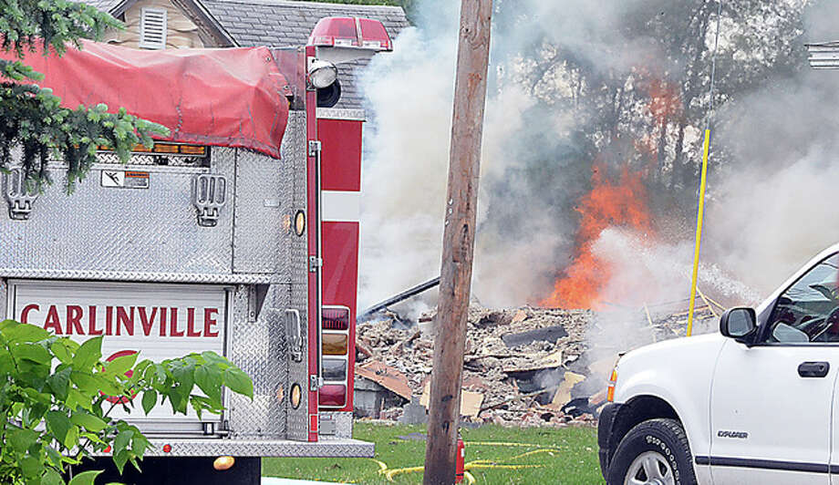 An explosion completely leveled a house in Carlinville, injuring two, Wednesday after a gas line was struck. Photo: Eric Becker | Macoupin County Enquirer Democrat