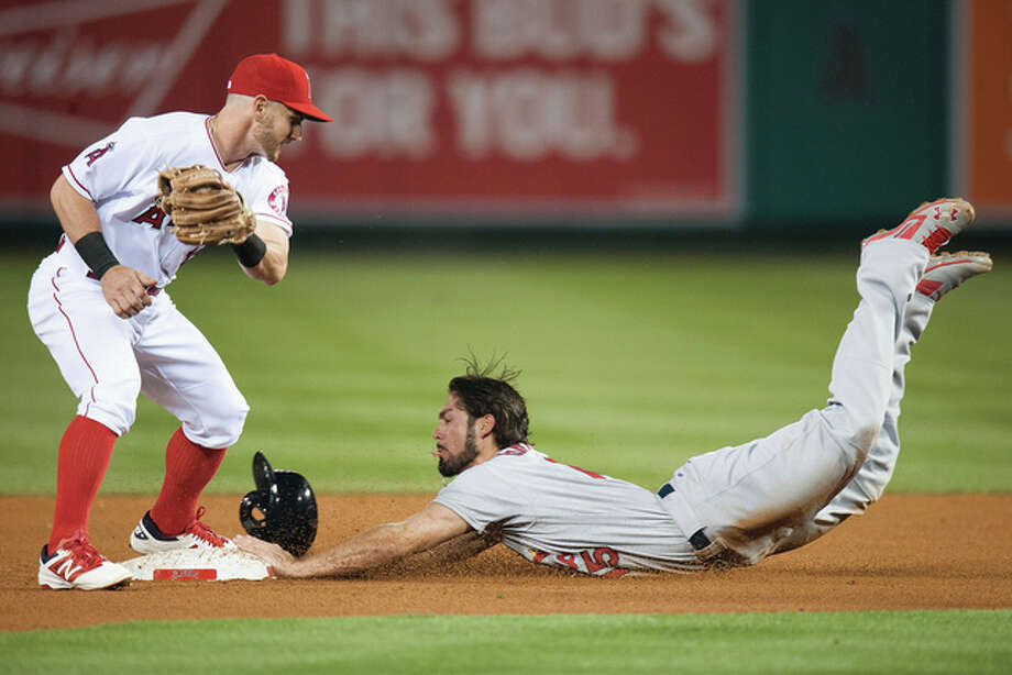 The Cardinals' Randal Grichuk (right) dives in with a stolen base before the Angels' Johnny Giavotella can apply a tag during the fourth inning Wednesday night in Anaheim, Calif. The Cardinals won 5-2. Photo: Associated Press