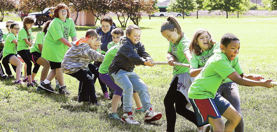 "Fifth grade students from Roxana's Central Elementary School play a game of tug of war at Education Day Friday at the Lewis and Clark State Historic Site in Hartford. The day is part of the ""Day of Departure"" celebration commemorating the departure of of the Lewis and Clark Expedition. Students learned about rope making, firearms of the period, how to make pottery, fold the American flag and toured a replica of the fort the expedition stayed in before heading up the Missouri River to explore the Louisiana Purchase."