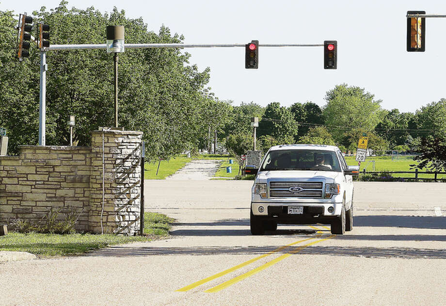 The city of Alton has received a grant to make major modifications to the entrance to both sides of Gordon Moore Community Park. The current two-lane entrance road to the south side of the park will become a four-lane road with one lane in and three lanes exiting the park. The new road will also align directly with the road to the north side of the park, background, which is currently offset from the south entrance on Illinois Route 140.