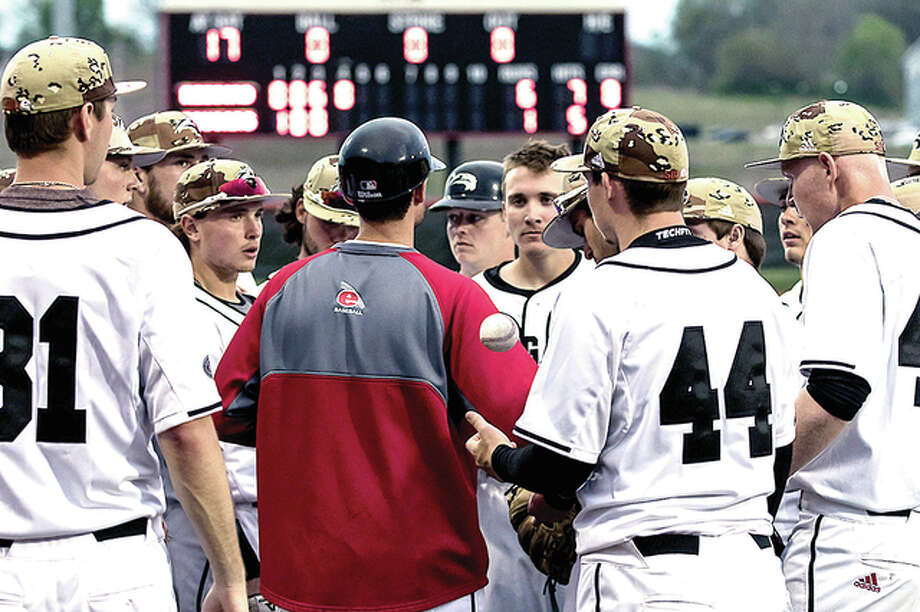 SIUE baseball coach Danny Jackson huddles his team in a recent game. The Cougars dropped the opener of a three-game home series to Austin Peay Friday night. Photo: SIUE Athletics