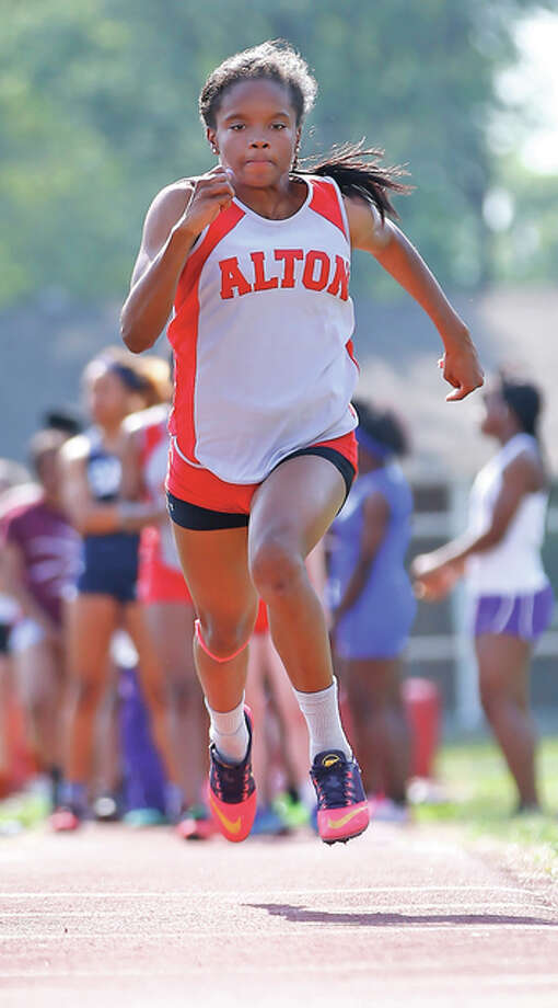 LaJarvia Brown won four events Friday evening at the IHSA Class 3A Girls Sectional Track Meet at Rock Island. She won the long jump, triple jump, 100 hurdles and 300 hurdles, qualifying for next weekend's IHSA State Meet in all four events. The defending state triple jump champ and last year's Telegraph Athlete of the Year, Brown is a Texas A&M recruit. Photo: Billy Hurst File Photo | For The Telegraph