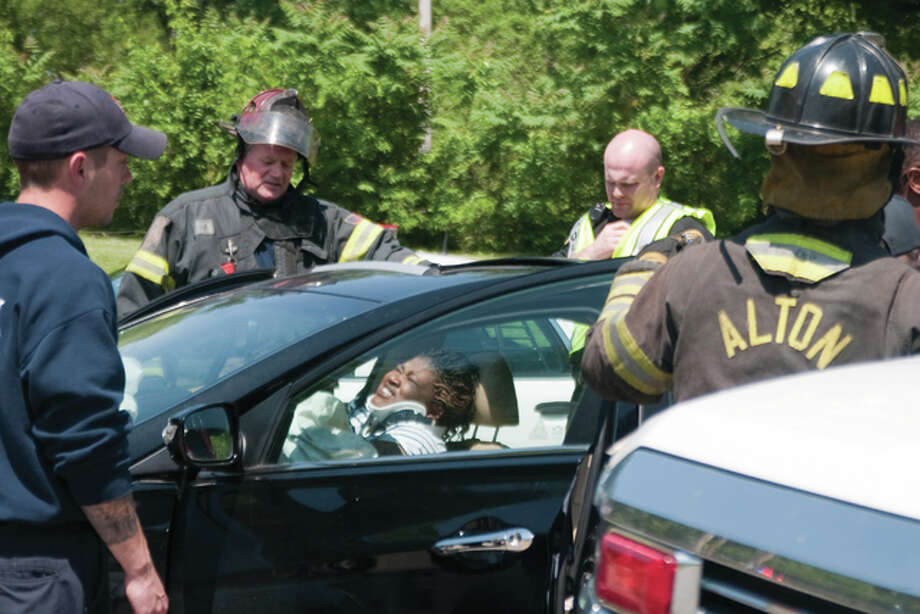 People involved in a three-vehicle crash suffered multiple injuries in the incident that occurred at approximately 1:30 p.m. Sunday at the intersection of 20th and Alby streets in Alton. First responders blocked roads that led to and intersected at the crossroads. Vehicles involved included a Sonata, a Ford Expedition and a Honda CR-V, pictured as it ultimately landed — on its side. First responders called for three ambulances and traffic control. Dan Cruz | For The Telegraph