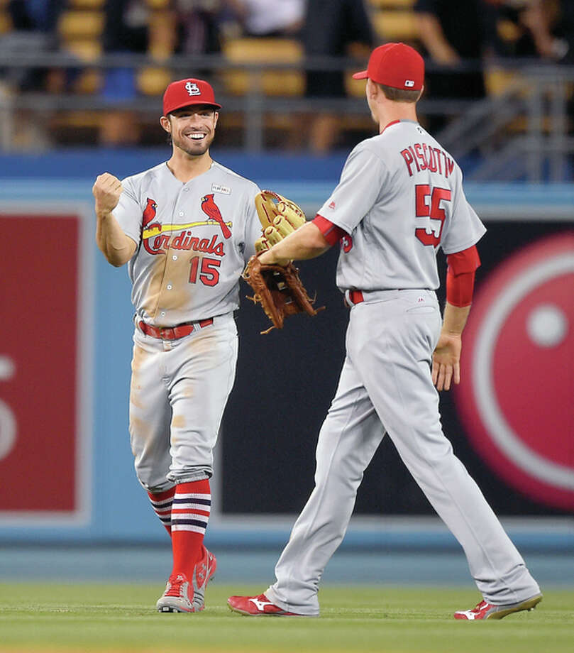 The Cardinals' Randal Grichuk, left, and Stephen Piscotty congratulate each other after their team's 5-2 win over the Los Angeles Dodgers Sunday night in Los Angeles. Photo: Mark J. Terrill | AP Photo