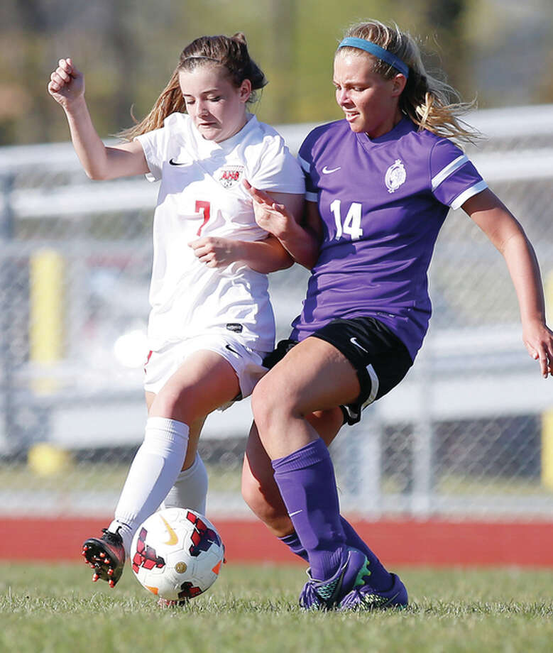 Alton's Alaina Nasello (7) and Kahoks Caydren Jones (14) Photo: Scott Kane | For The Telegraph
