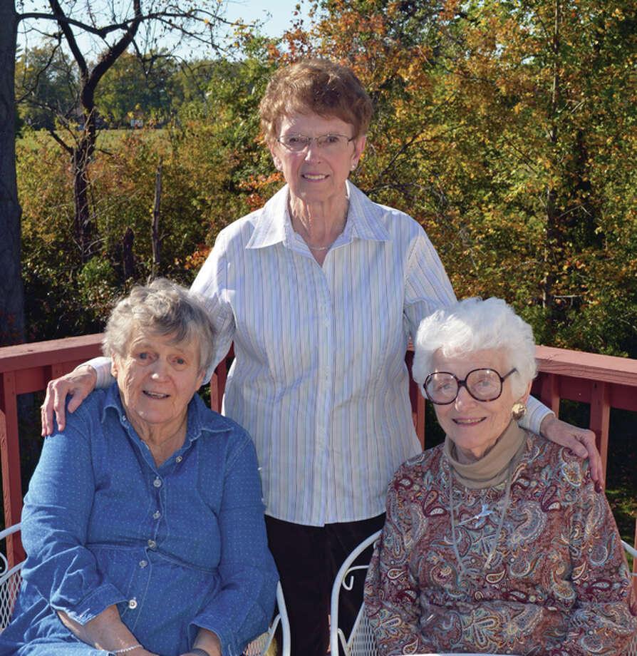 Alton Community Service League longtime members Rosemary Wuellner, front left, with 31 years of service, and Laura Hellrung, front right, with 41 years of service, were voted emeritus members during the organization's 60th anniversary year. This year's president is Jean Conrady, center.