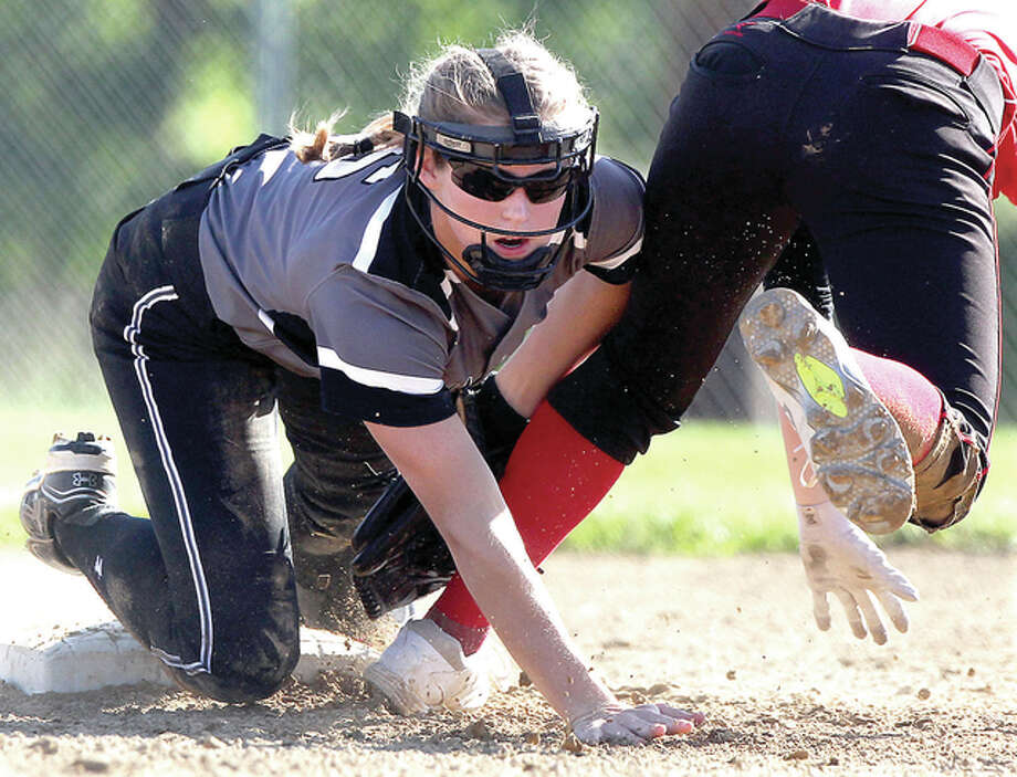 West Central's Alexis Moore tags out a Bunker Hill player trying to stretch a single into a double during the semifinals of the Greenfield Regional in Greenfield Wednesday afternoon. Photo: Dennis Mathes, Journal-Courier | For The Telegraph