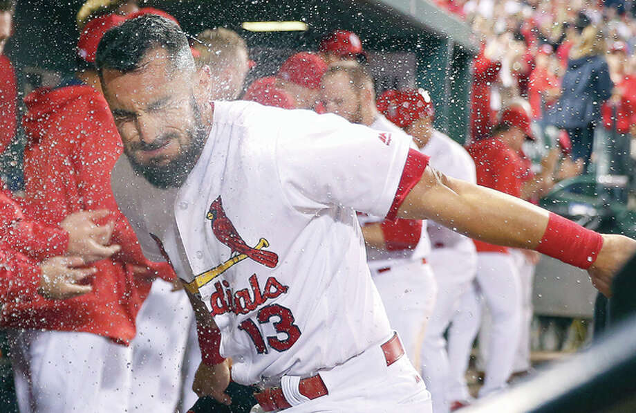 The Cardinals' Matt Carpenter is splashed with water by a teammate after hitting a three-run home run in the eighth inning against the Colorado Rockies Thursday in St. Louis. Photo: Jeff Roberson | AP Photo