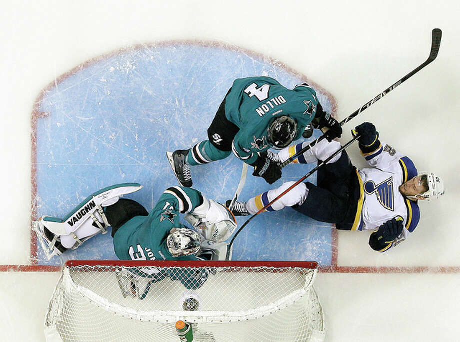 The Blues' Paul Stastny (26) falls down next to San Jose Sharks' Brenden Dillon (4) as goalie Martin Jones makes a save during the third period of Game 3 of the Western Conference finals Thursday night in San Jose, Calif. San Jose won 3-0. Photo: Marcio Jose Sanchez | AP Photo
