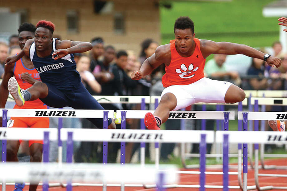 Edwardsville's Travis Anderson (right) leads Belleville East's William Session in the 110-meter high hurdles during the Collinsville Class 3A Sectional meet on Friday. Anderson won the race, with Session placing second. Anderson also won the 300 intermediate hurdles and will be a state title contender in both races next weekend at Charleston. Photo: Billy Hurst / For The Telegraph