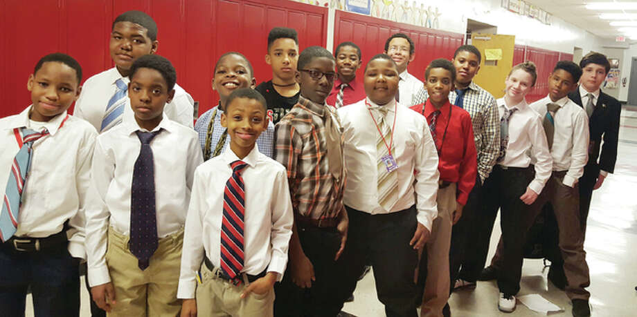 Members of the Distinguished Gentleman's Club at Alton Middle School show off their dress clothes. The club provides positive mentoring for young men at the school, and one of their activities is to dress up in a shirt, dress, pants and tie, once a week.