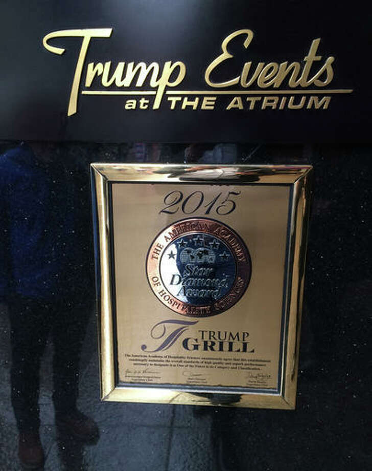 A plaque awarding the Trump Grill five stars by the American Academy of Hospitality Sciences is seen displayed in the Trump Towers in New York. Joseph Cinque, a longtime friend of developer and presidential candidate Donald Trump, has run American Academy of Hospitality Sciences for years. A review by The Associated Press shows that more than a dozen of its board trustees are Trump friends, relatives or business associates.