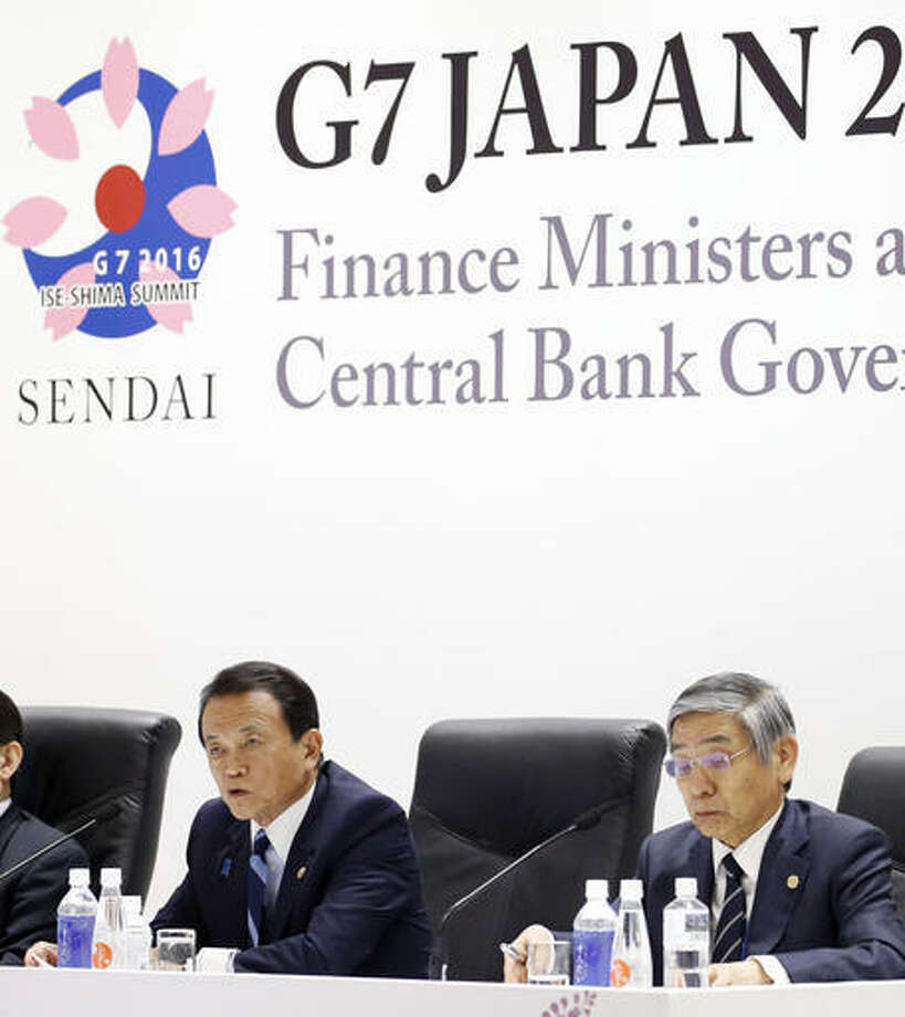 Japanese Finance Minister Taro Aso, left, speaks next to Bank of Japan Gov. Haruhiko Kuroda, right, during a press conference after a meeting of finance ministers and heads of central banks of the Group of Seven in in Akiu, northern Japan, Saturday. The G7 major economies showed a united front on fighting terrorist financing and tax evasion in talks that ended Saturday, but shied away from coordinated action on policies to revive stalling growth.