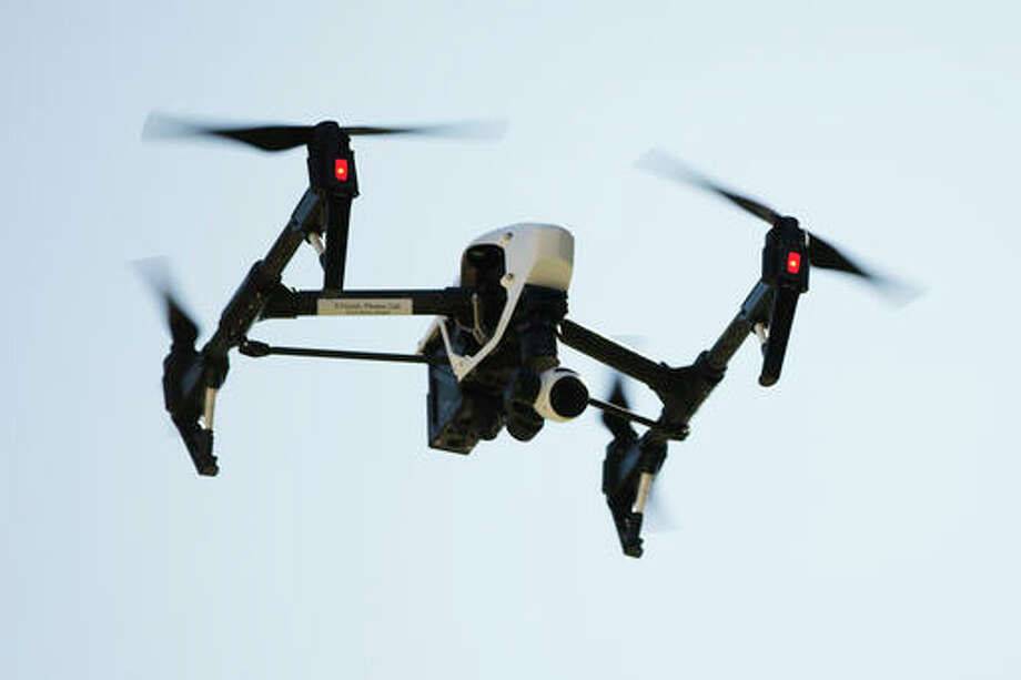 In this April 14, 2016 file photo, a drone operated captures videos and still images of an apartment building in Philadelphia. A panel of privacy experts and technology companies organized by the Obama administration has issued guidelines for using drones without being overly intrusive. The suggestions are voluntary, but some business interests involved in the debate hope the guidelines head off tougher regulations that they fear could smother the drone industry in its infancy.