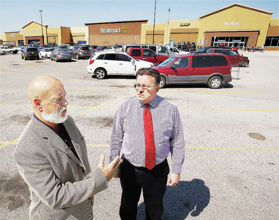 Wood River City Manager Jim Schneider, left, and Mayor Frank Akers, right, talk about the growth of the business district around the Wal-Mart Supercenter on Wesley Drive. Photo: John Badman | The Telegraph