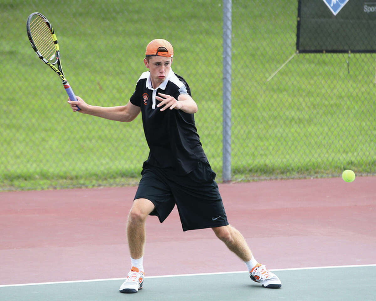 Edwardsville's Alex Gray hits a shot during his semifinal doubles match Saturday morning at the Edwardsville Sectional. Gray and freshman Zach Trimpe teamed up to win the sectional championship while losing just one game in four matches in the tourney.