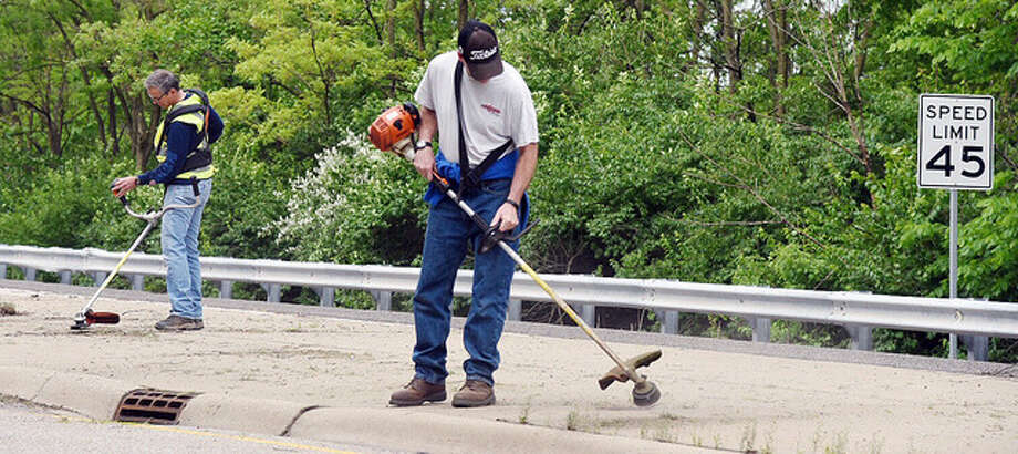 The North Alton-Godfrey Business Council spent Saturday morning cleaning up the median along Route 67.