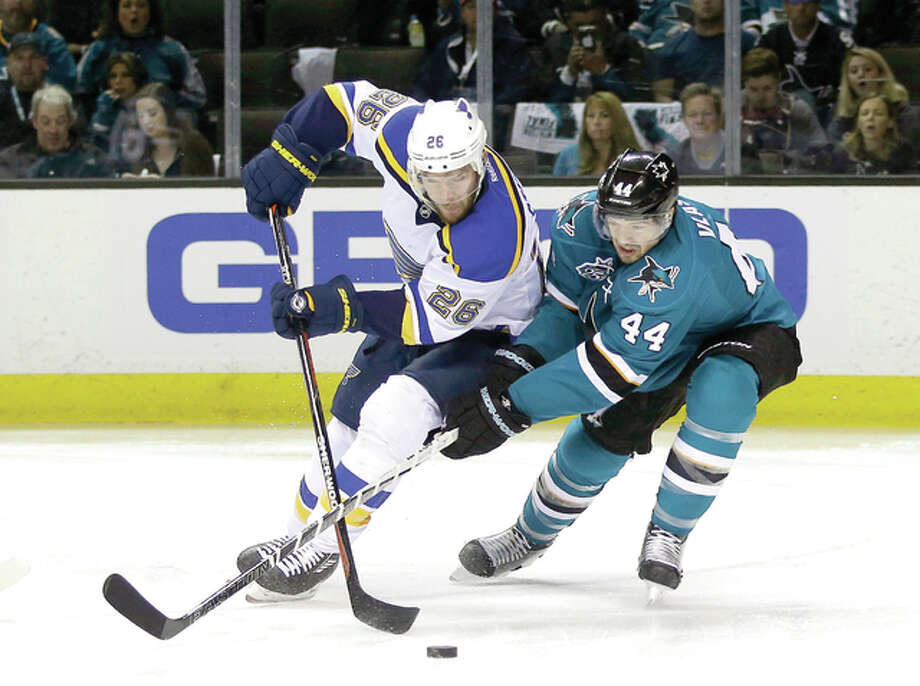 Paul Stastny of the Blues (26) is defended by San Jose Sharks' Marc-Edouard Vlasic (44) during Game 4 of the NHL Stanley Cup Western Conference finals Saturday in San Jose, Calif. Photo: Marcio Jose Sanchez | AP Photo