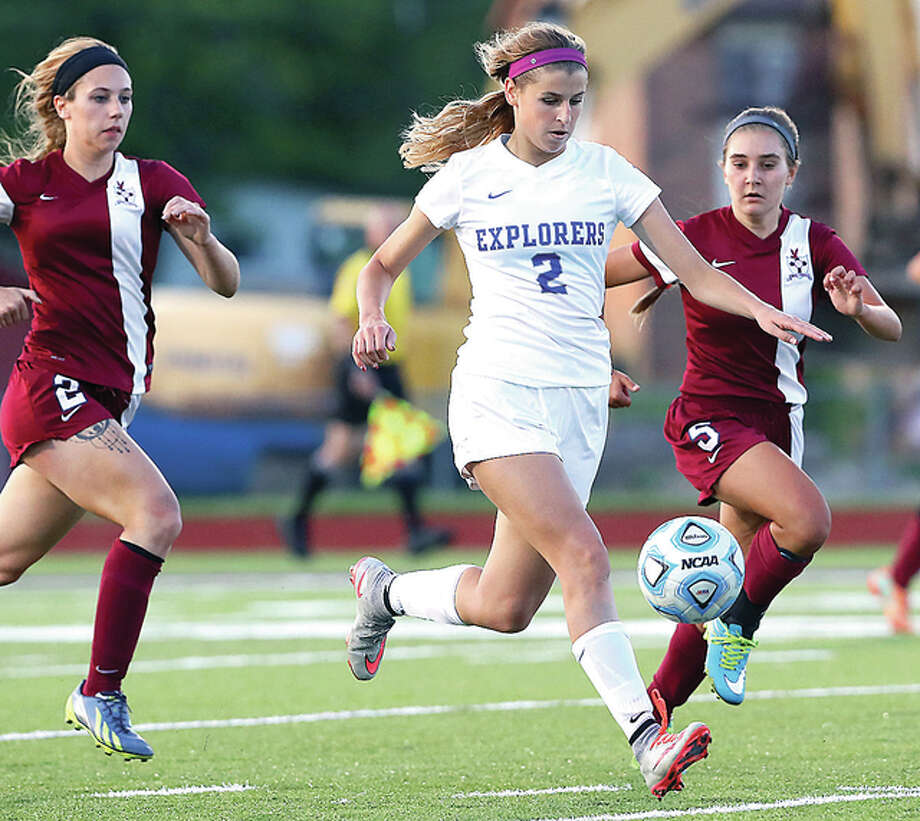 Marquette's Annabelle Copeland, middle, splits Gibault defenders Robyn Lindsey, left, and Monica Shuler during sectional semifinal action last week at McKendree University. Photo: Billy Hurst | For The Telegraph